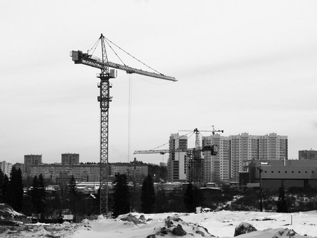 The construction crane in the sity, outdoor