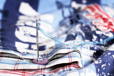 Needle and thread, shirt fabric, hobby object