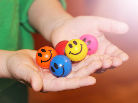 Fun colorful balloons in childrens hands, toy Stock Photo