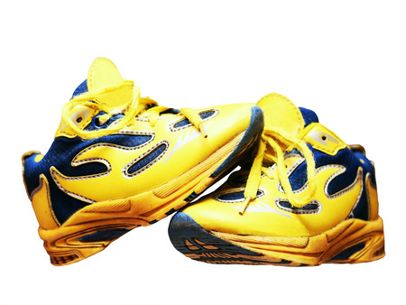 Yellow vintage sneakers on white background. Children's shoes. Isolated