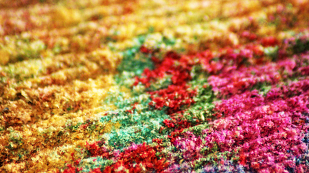 Colorful sand as the background image with wave-shaped structure. Sawdust wood.