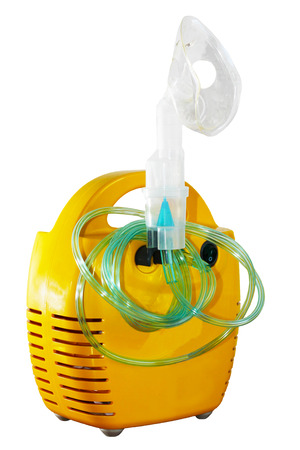 Yellow inhaler nebulizer compressor on white background