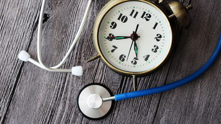 Clock Doctor, watch and stethoscope medical, object Stock Photo