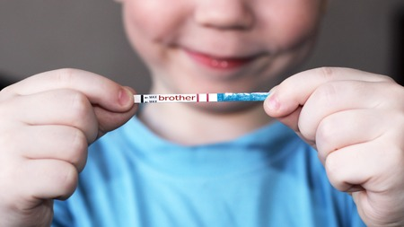 Pregnancy test in in children's hands, health