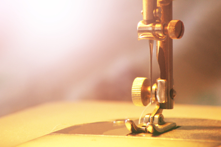 Close-up detail of the sewing machine, toned
