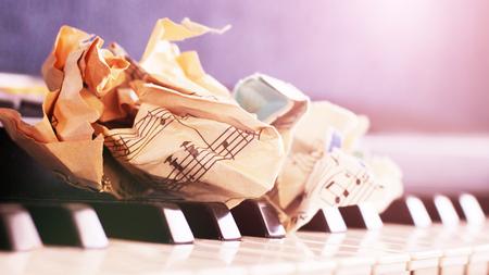 close-up music score on piano keyboard, piece of paper, object Archivio Fotografico