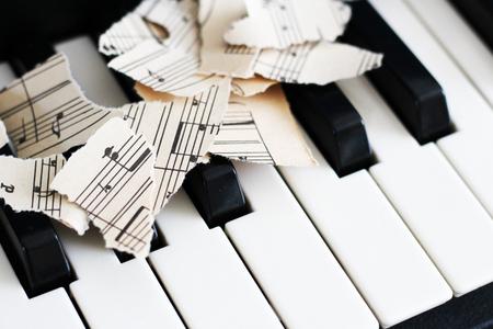 close-up music score on piano keyboard, piece of paper, object Stock Photo