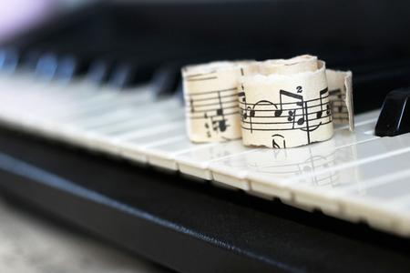 close-up music score on piano keyboard, piece of paper, object Reklamní fotografie