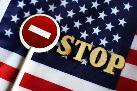 Road stop sign on a background of America flag, object Stock Photo