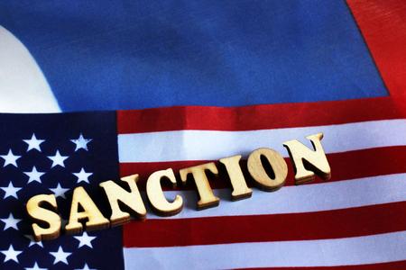 usa flag sanctions wooden letters on them, object Zdjęcie Seryjne