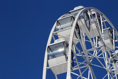 Ferris wheel municipal park with blue clear sky on the background, object