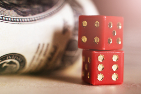 Red dice so close and money, toned photo, macro