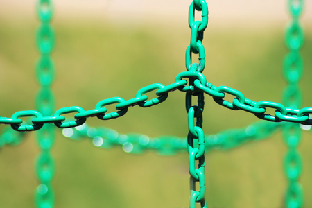 Green metal chain for protection, outdoor object