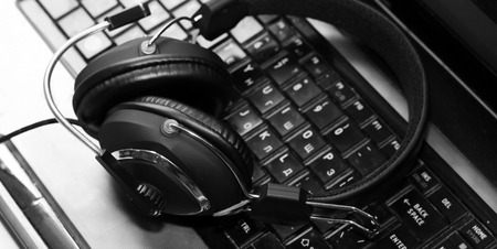 Large headphones on the computer, music device