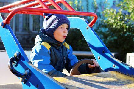 Boy swinging on swing cars, Playground outdoor Stok Fotoğraf