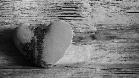 broken heart concept, wooden background, black and white Imagens
