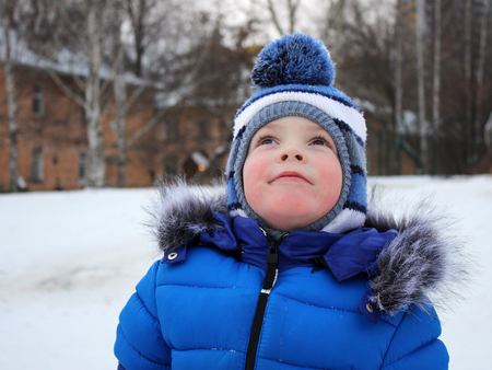 Portrait of a boy in winter so close