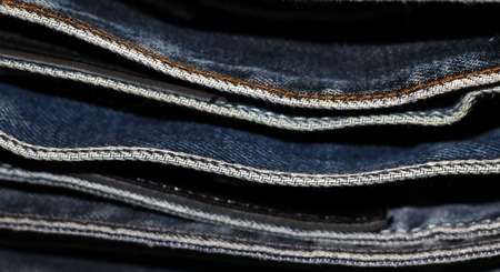 Stack of blue jeans, concept for fashion, background