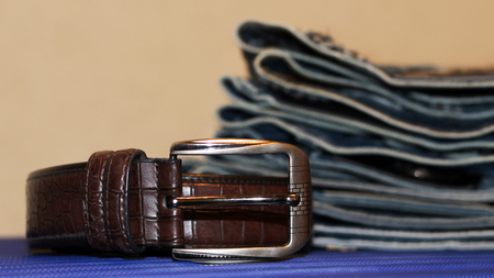 Blue jeans and brown leather belt, fashion 스톡 콘텐츠