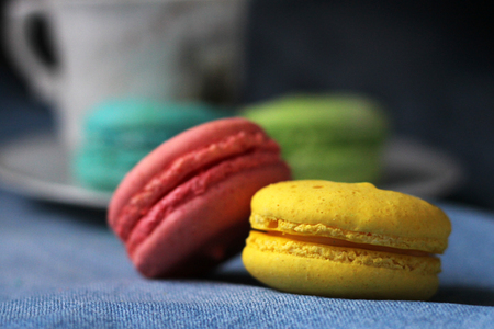 Colorful macaroons. Holiday time concept, so close 免版税图像