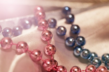 Blue and pink beads are very close, toned