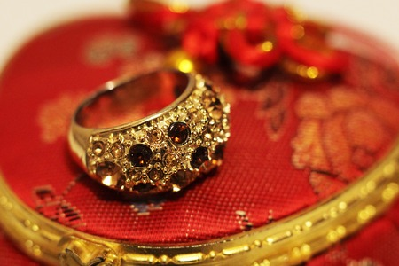 Large gold ring with stones, luxury