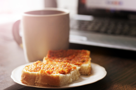 Sandwich with orange caviar and cup of tea