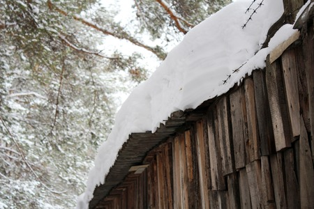 Snowing on a wooden fence, old object