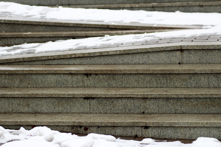 Zigzag ramp for the wheelchair and stairs for normal people adjoining, snow