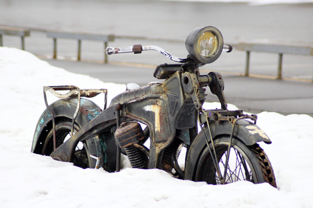 A motorcycle covered in snow, metal sculpture