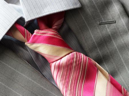 Pink tie and grey mens jacket so close