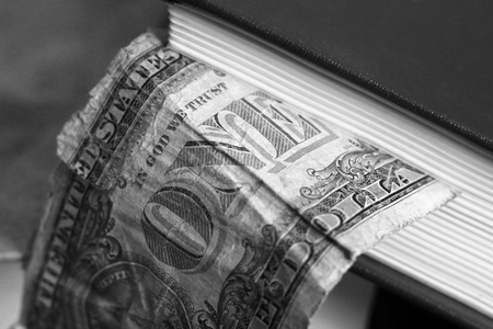 One dollar and book so close, money Imagens