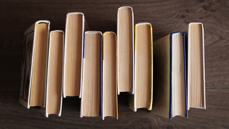old books on wooden table top view, set