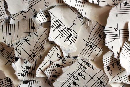 Torn musical notes, pieces of paper so close Stok Fotoğraf