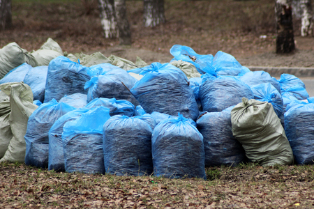 Translucent trash bag pile on the side walk, outdoor