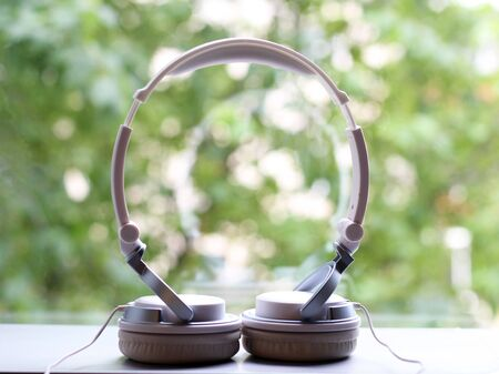 White elegance headfones on nature background, music