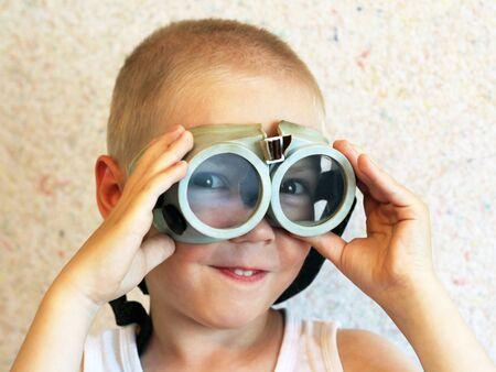 Boy in retro swimming glasses, funny 版權商用圖片
