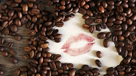 Fresh coffee beans and lipstick lips, so close