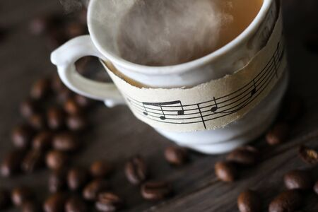 A Cup of hot coffee, musical notes so close Foto de archivo - 128256374