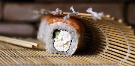 Delicious rice and fish rolls. Traditional Japanese cuisine. So close. Foto de archivo - 128256450