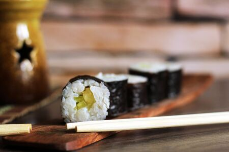 Delicious rice and fish rolls. Traditional Japanese cuisine. So close. Foto de archivo - 128256533