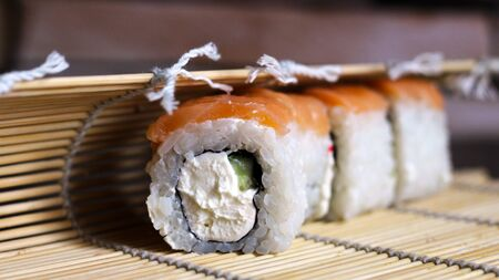Delicious rice and fish rolls. Traditional Japanese cuisine. So close. Foto de archivo - 128256607