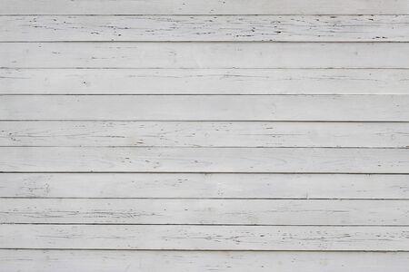 verwitterter Holzplankenzaun, alter Hintergrund Standard-Bild