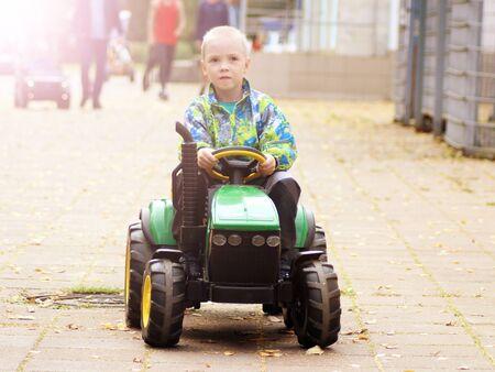 A little boy on an electric tractor, outdoor Stok Fotoğraf