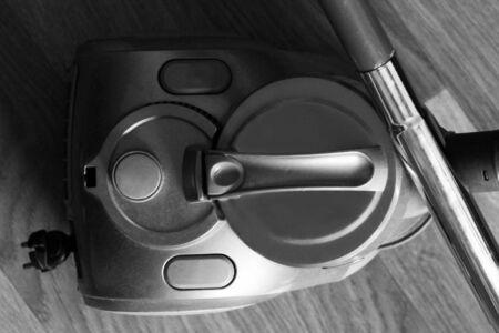 vacuum cleaner on wooden floor so close, monochrome Stock Photo