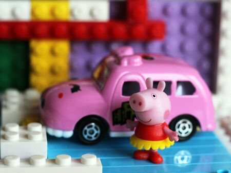 Pig toy with car so close.