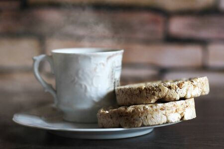 A Cup of steamed coffee and two healthy breads Stockfoto