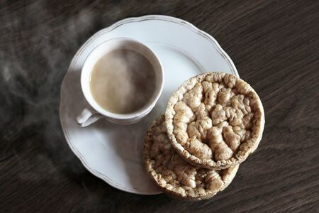 A Cup of steamed coffee and healthy breads, top view food