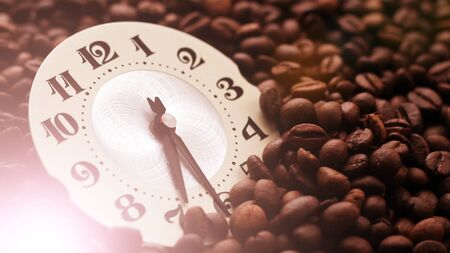 Alarm clock standing on the beans of coffee. Coffee time concept. So close.