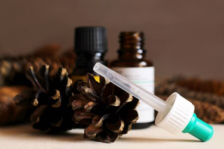 Medicine and pine cones, plant extract. The scent of the forest. Object.